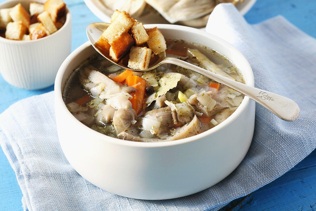 Oyster mushroom and vegetable soup with croutons