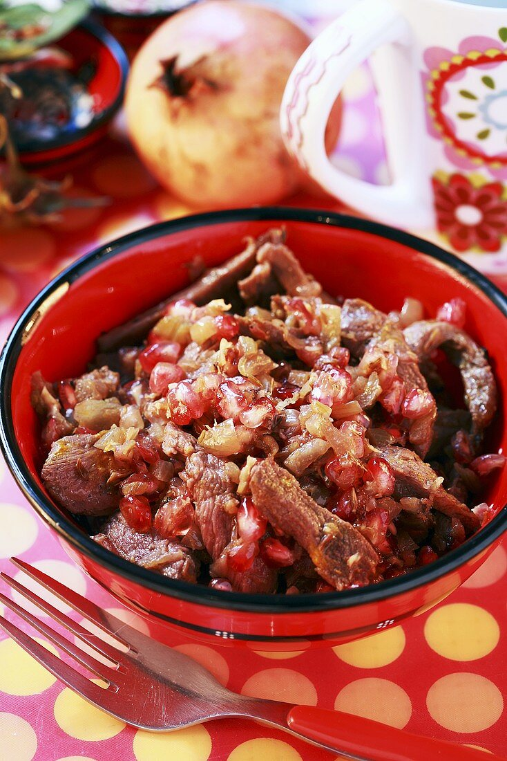 Duck goulash with pomegranate seeds