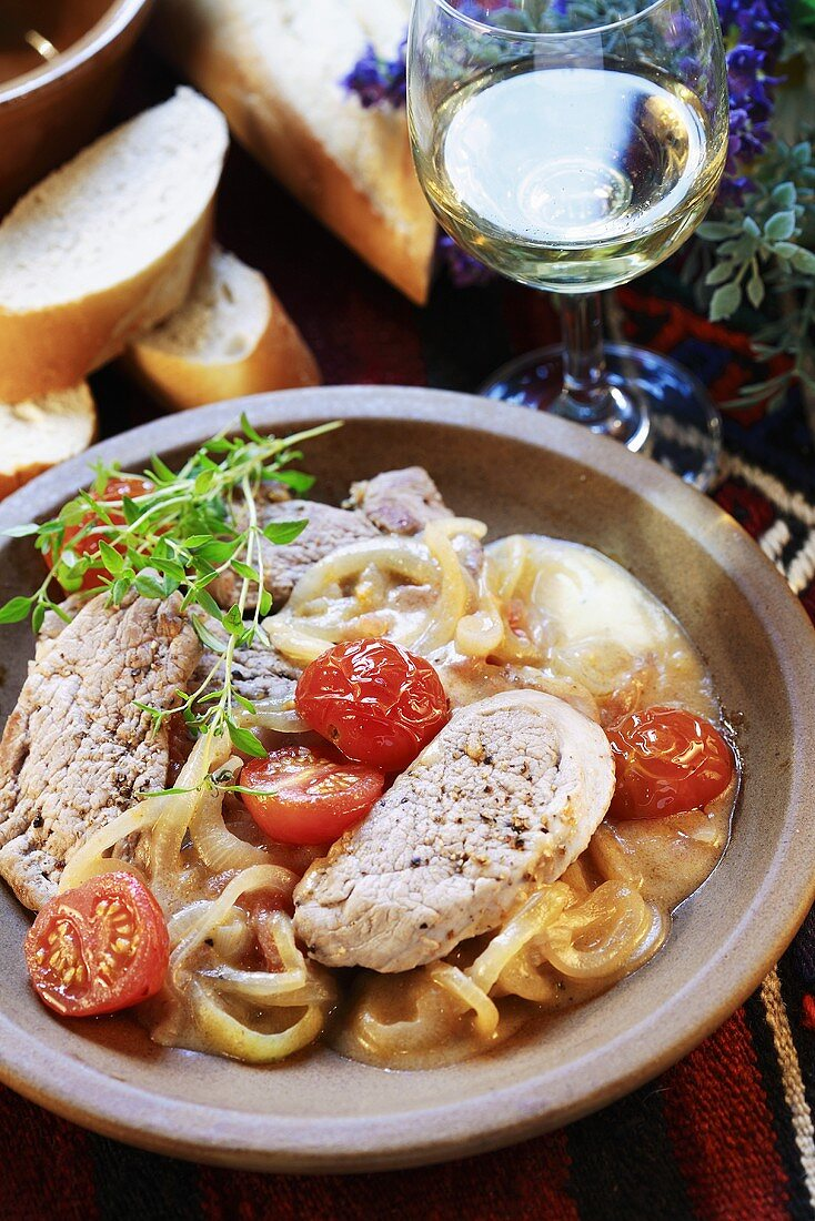 Pork in onion and white wine sauce