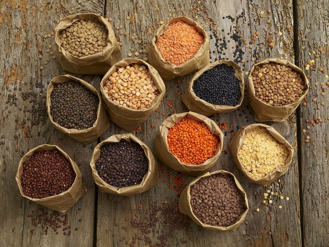 Various types of lentils in paper bags