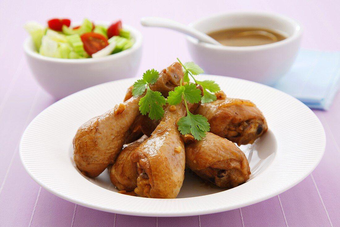 Garlic chicken legs with side salad