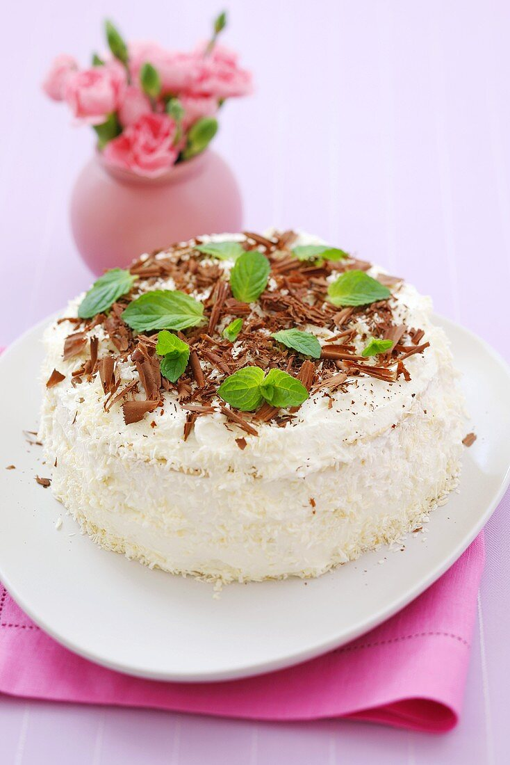 Coconut cake with chocolate shavings and mint