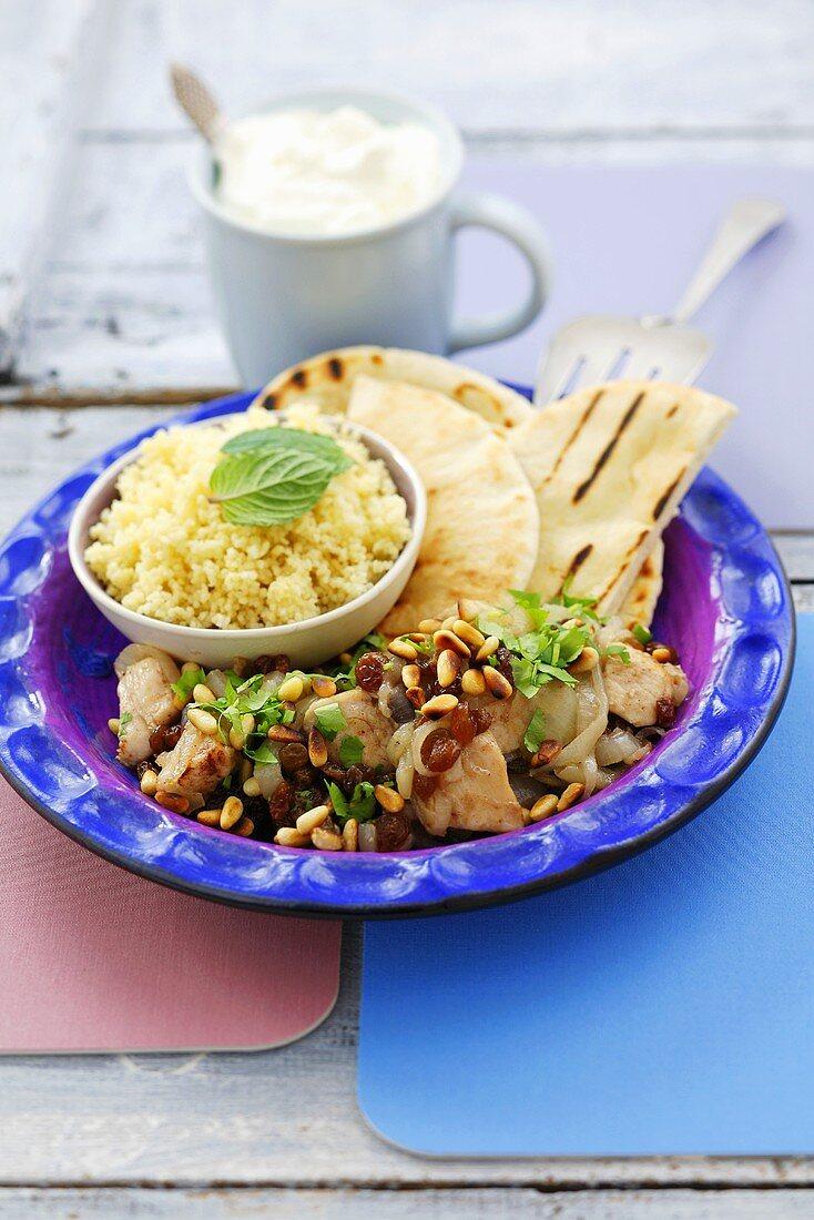 Chicken breast with raisins, pine nuts, pita bread & couscous