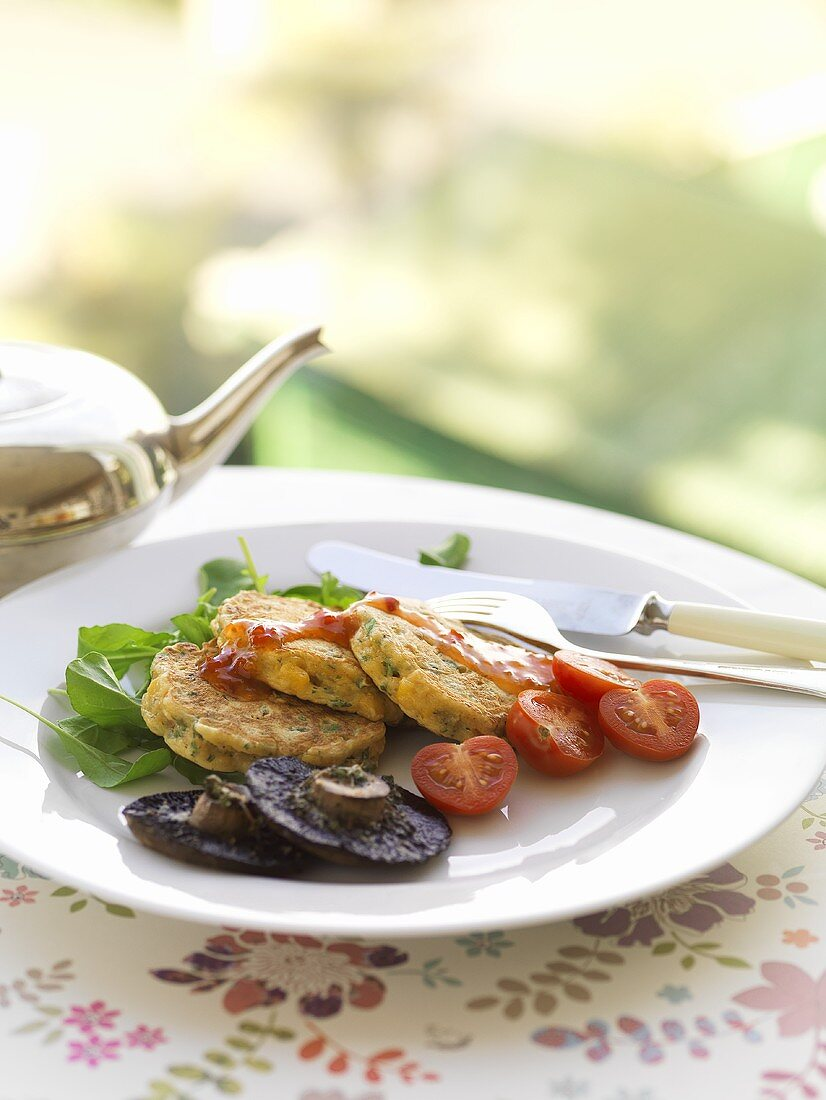 Corn cakes with tomatoes and mushrooms