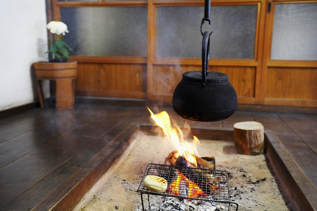 Irori (Japanese sunken hearth with sandy floor for cooking & heating)