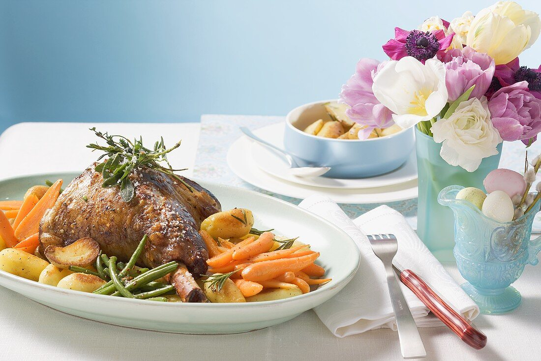 Roast lamb shank with herbs and vegetables