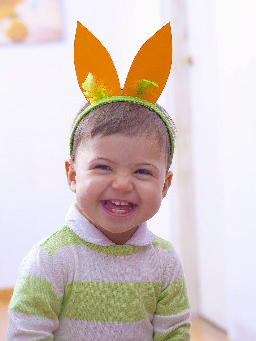 Little boy wearing rabbit ears