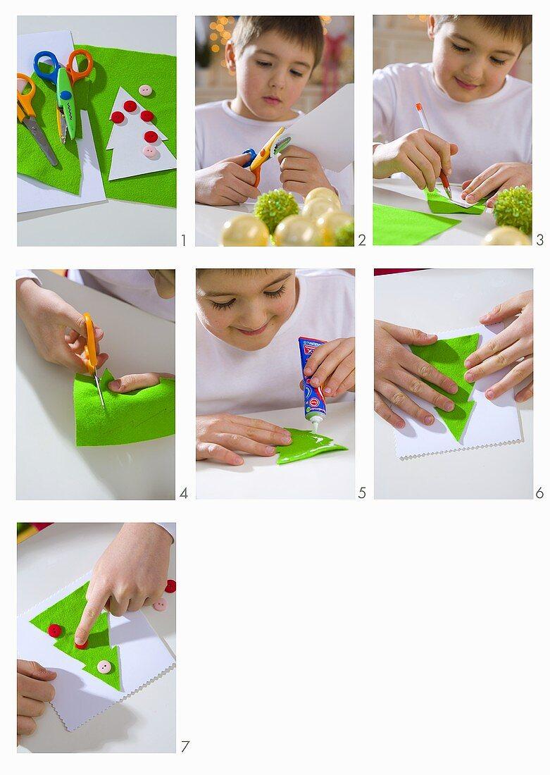 Boy making Christmas cards
