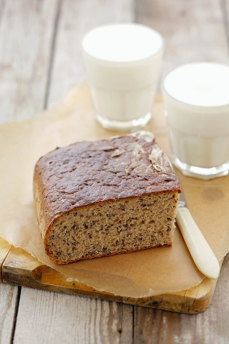 Sourdough bread with linseed and two glasses of kefir
