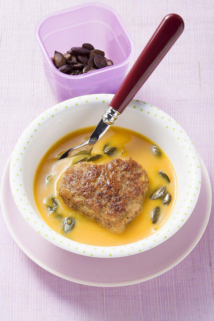 Heart-shaped burger with pumpkin soup