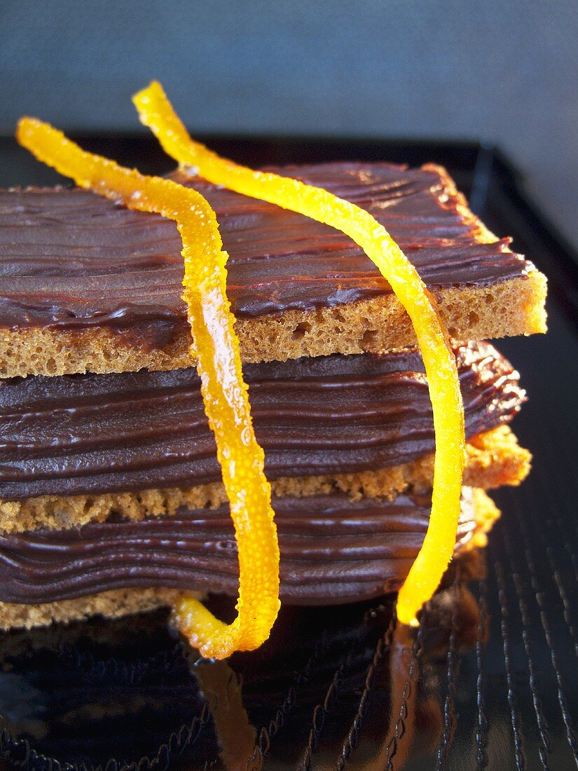 Stacked slices of bread with chocolate spread & candied orange peel