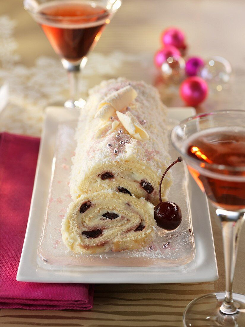 Festive sponge roll with cherry filling, with dessert wine