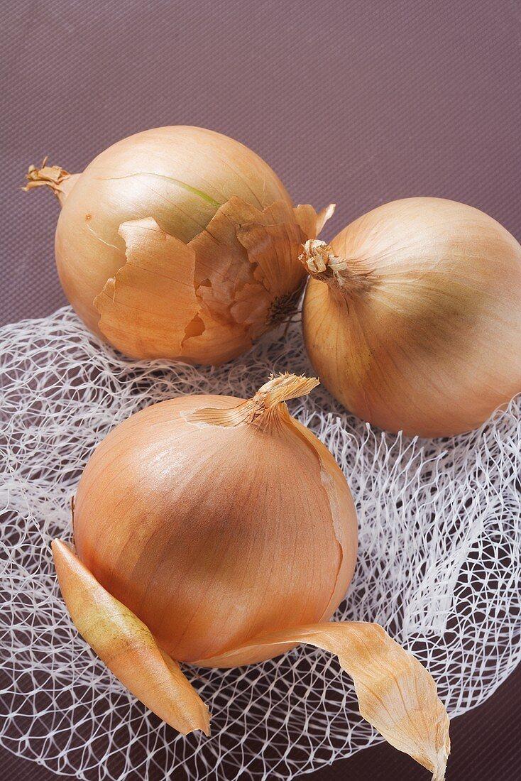 Three onions on a net bag