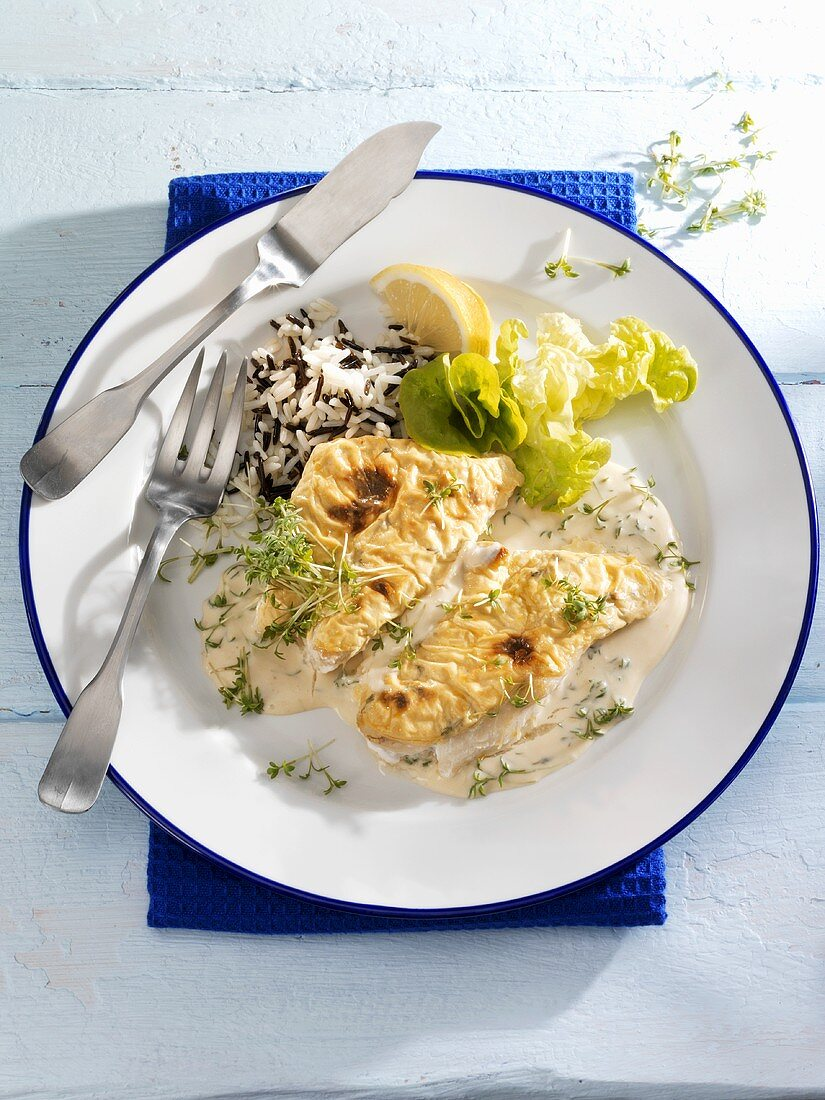 Redfish fillet with gratin topping in mustard sauce, wild rice