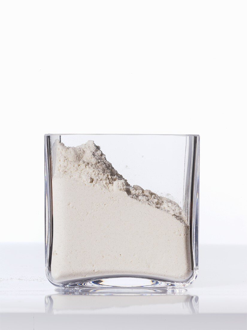Wheat flour in a square glass