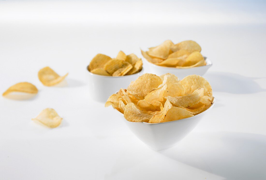 Crisps in three small bowls