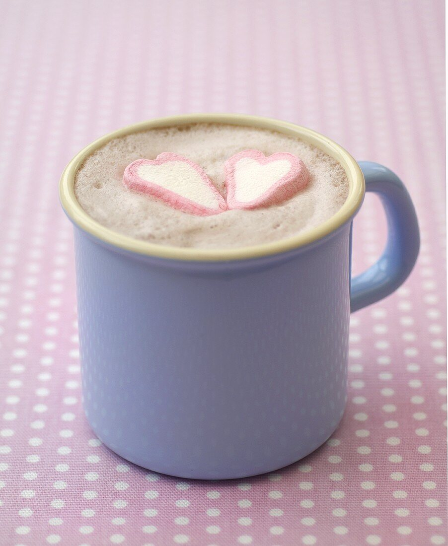 Hot chocolate with two marshmallow hearts