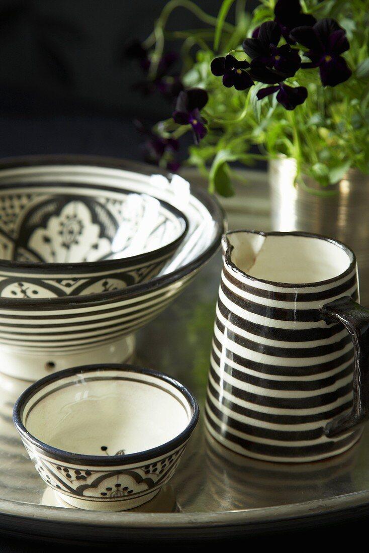 Ceramic bowls and a jug on tray