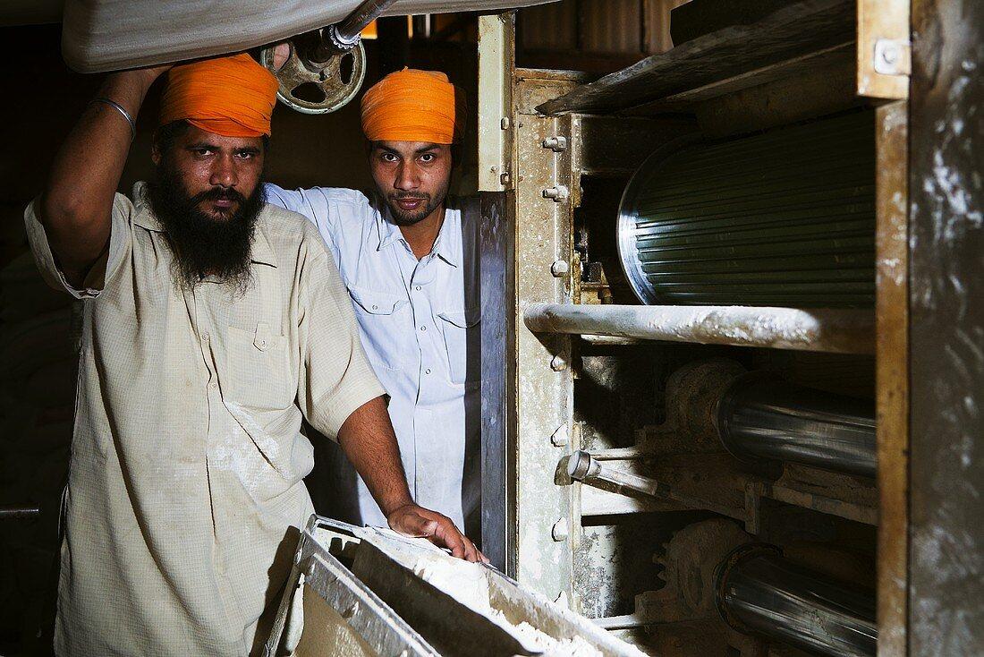 Baking bread in a communal kitchen (Langar), Amritsar, Punjab, India