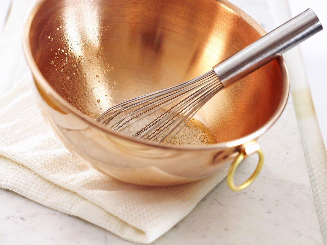 Egg white in a copper bowl