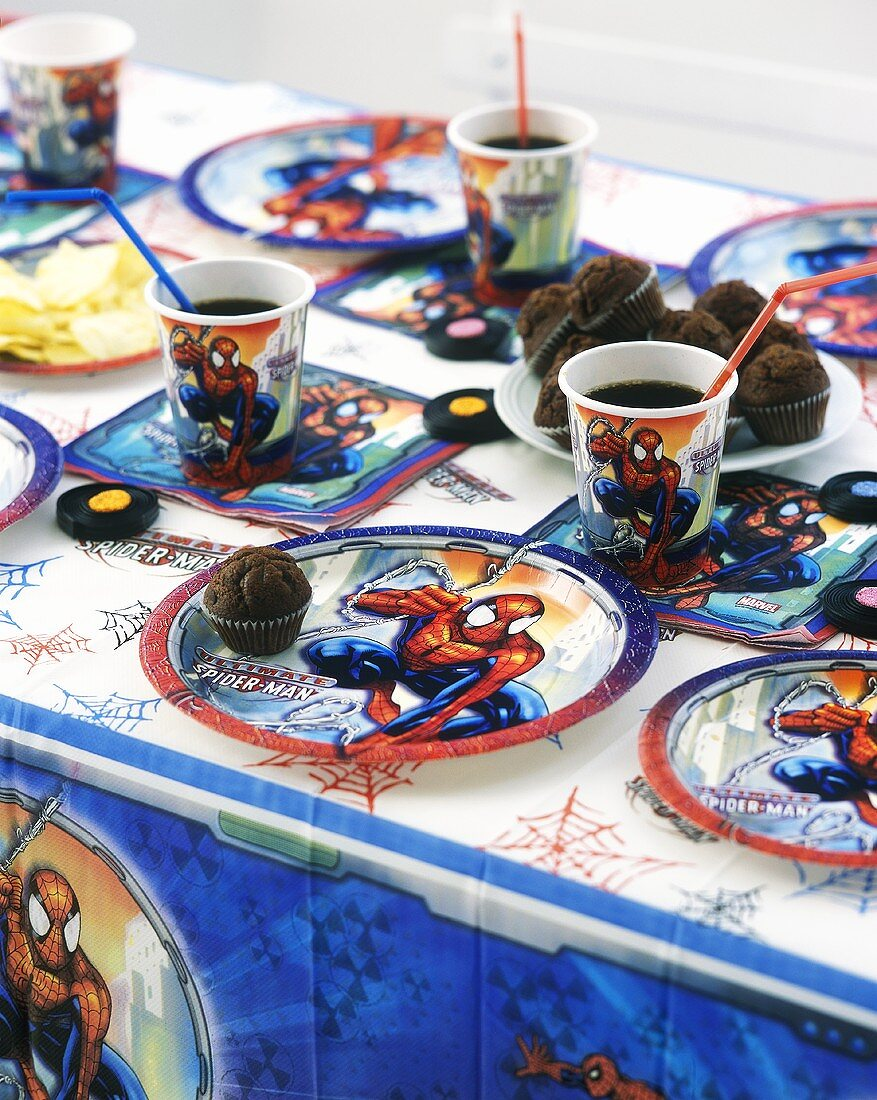 Children's Spiderman party with chocolate muffins, liquorice and drinks