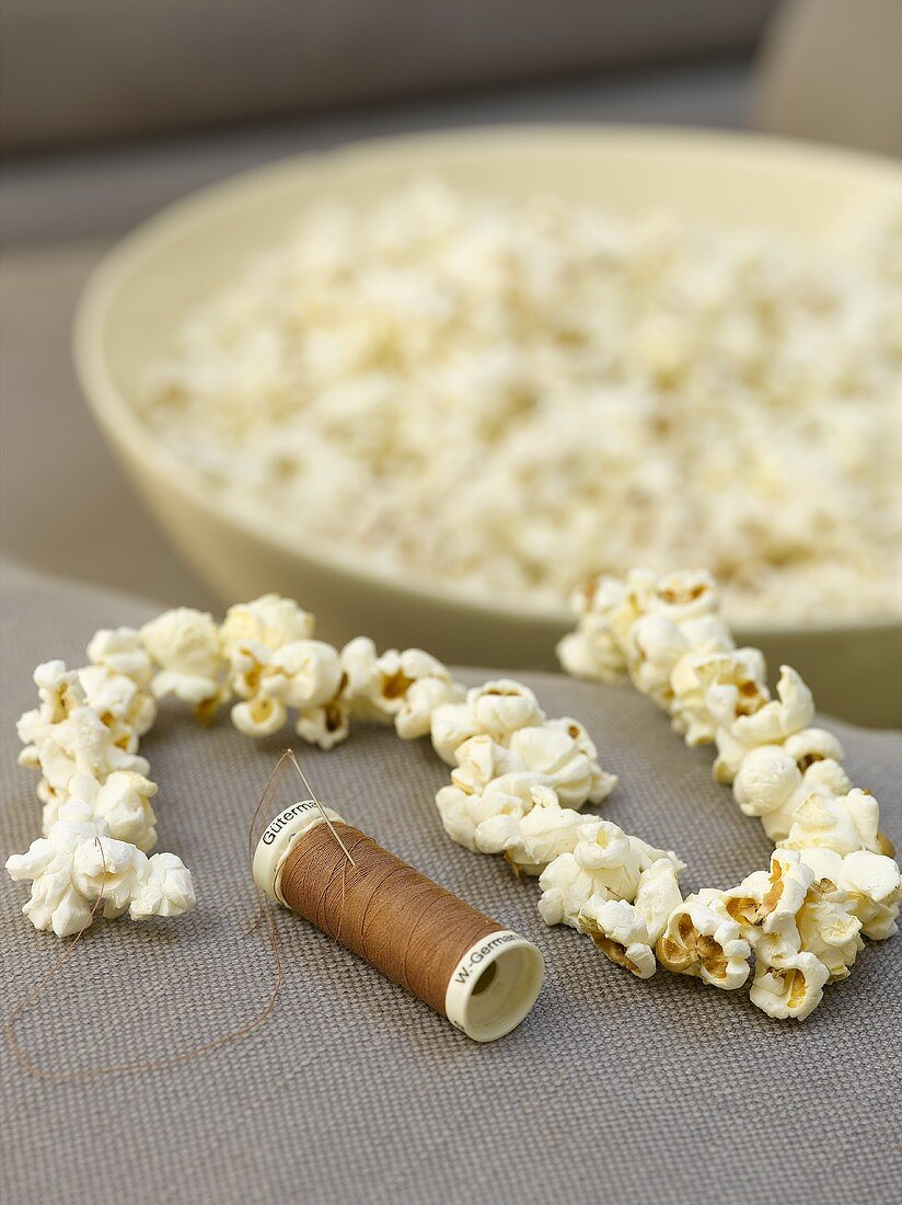 Chain of popcorn with needle and thread