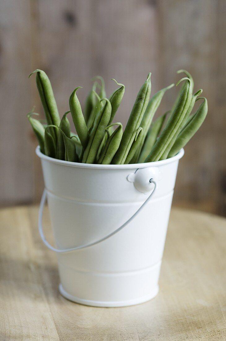 Green beans in enamel bucket