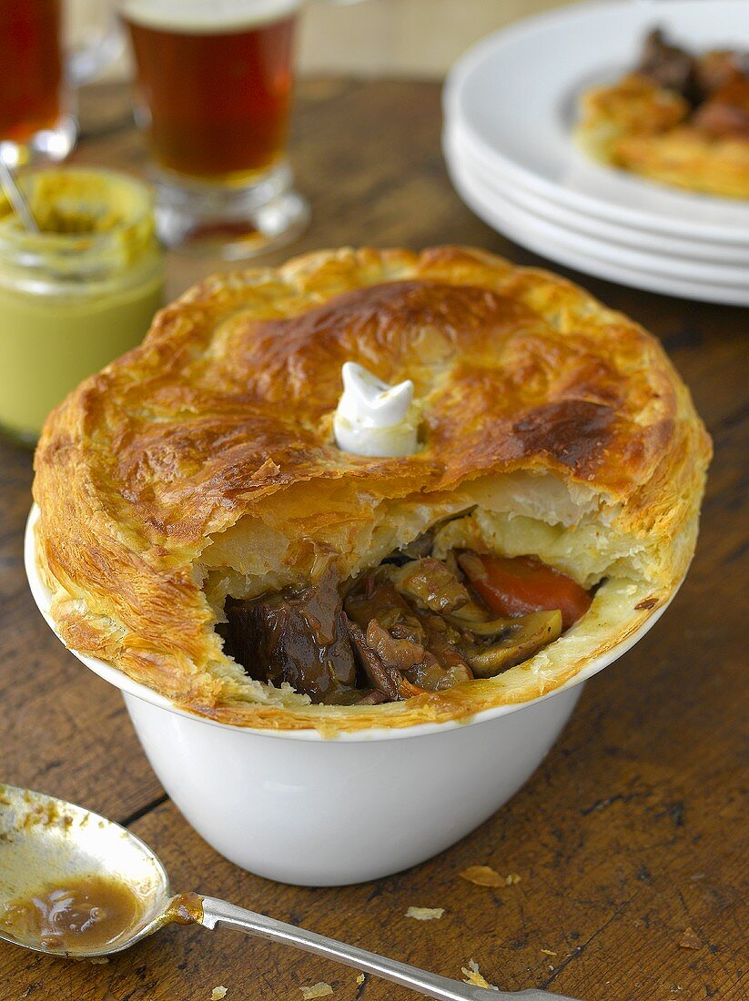 Steak and ale pie with a puff pastry lid (England)