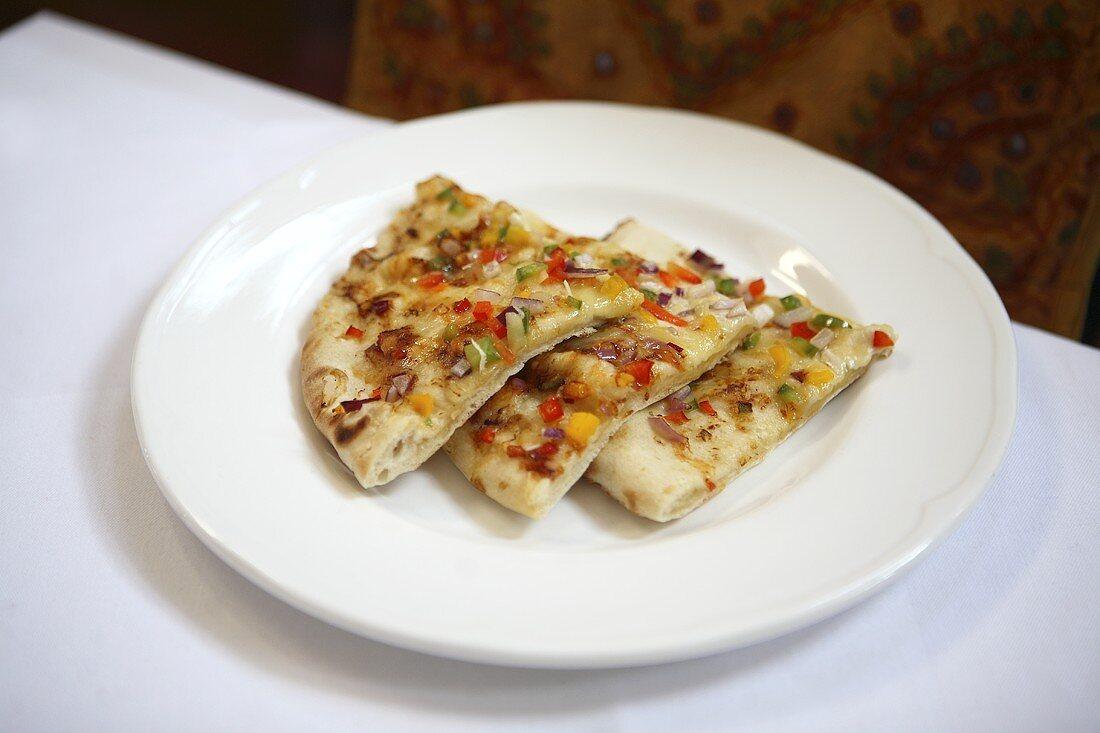 Three slices of vegetable pizza