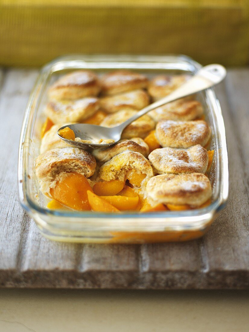 Peach cobbler in a baking dish