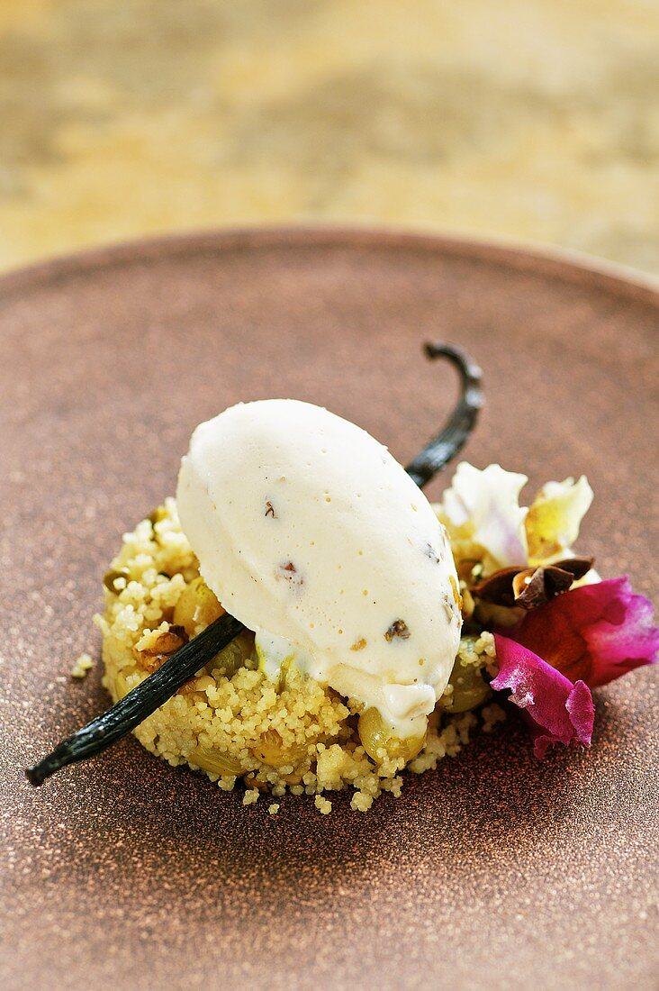 Couscous with grapes, nuts and rum and raisin ice cream