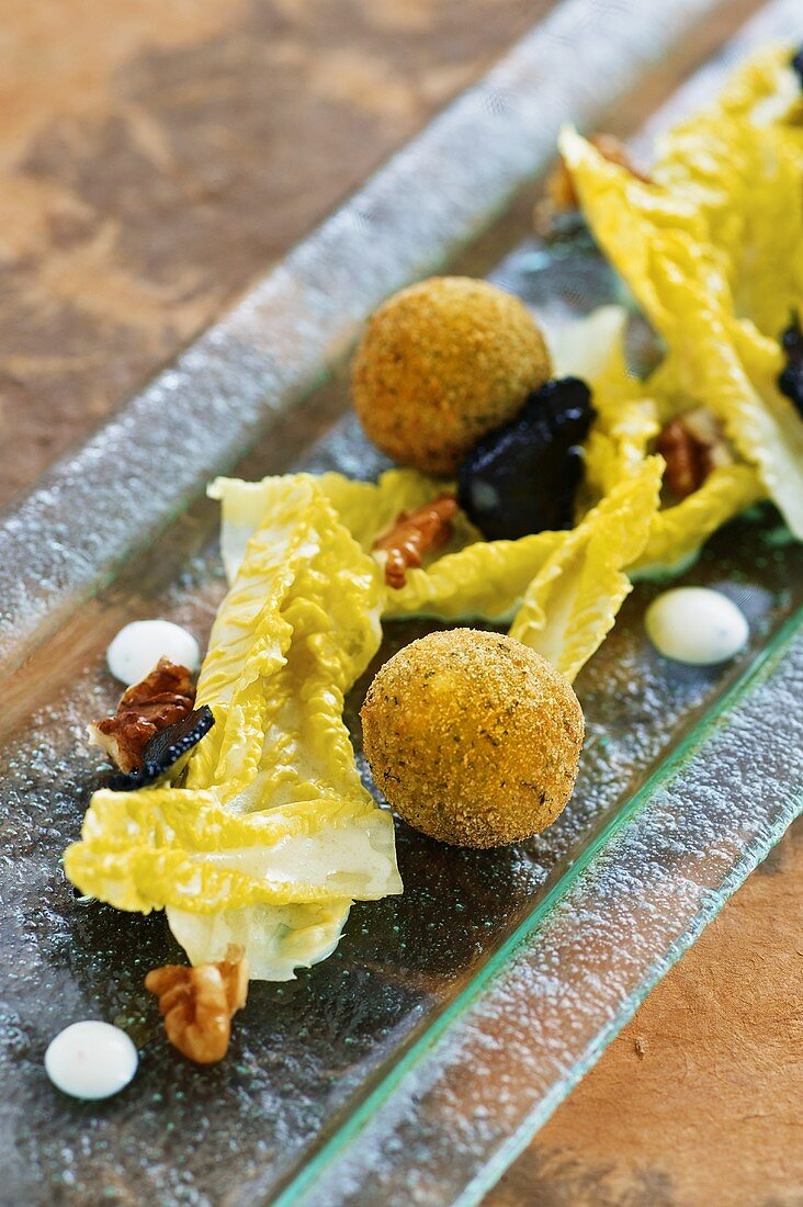 Truffled spring chicken croquets with lettuce hearts and a nut dressing