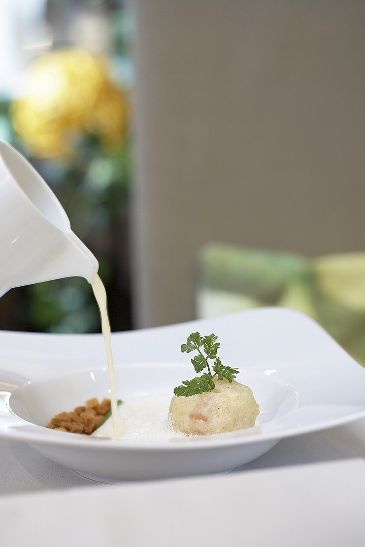 Wine foam soup with herb bacon and sorrel puree