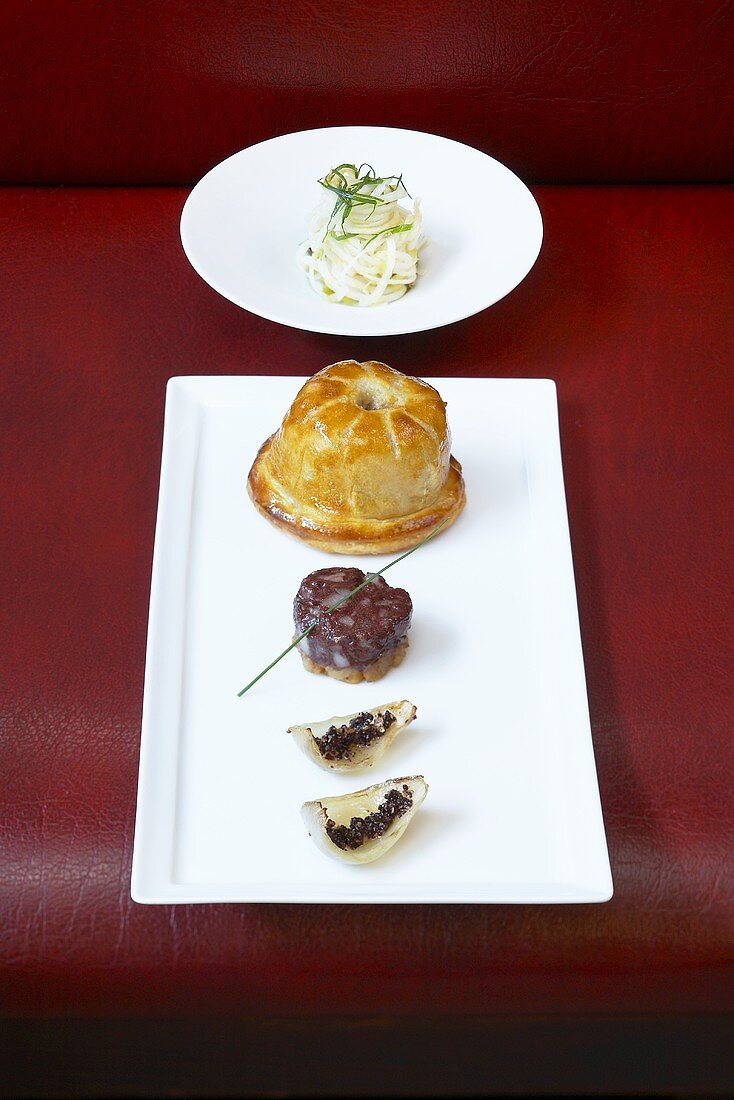 Rabbit pie with 'Himmel und Erde' (black pudding, fried onions, and mashed potato with apple sauce)