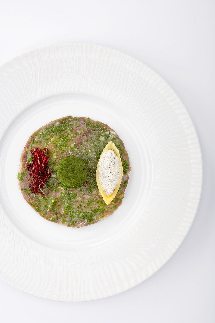 A variation on veal (veal head, veal tongue tartlet and risotto)