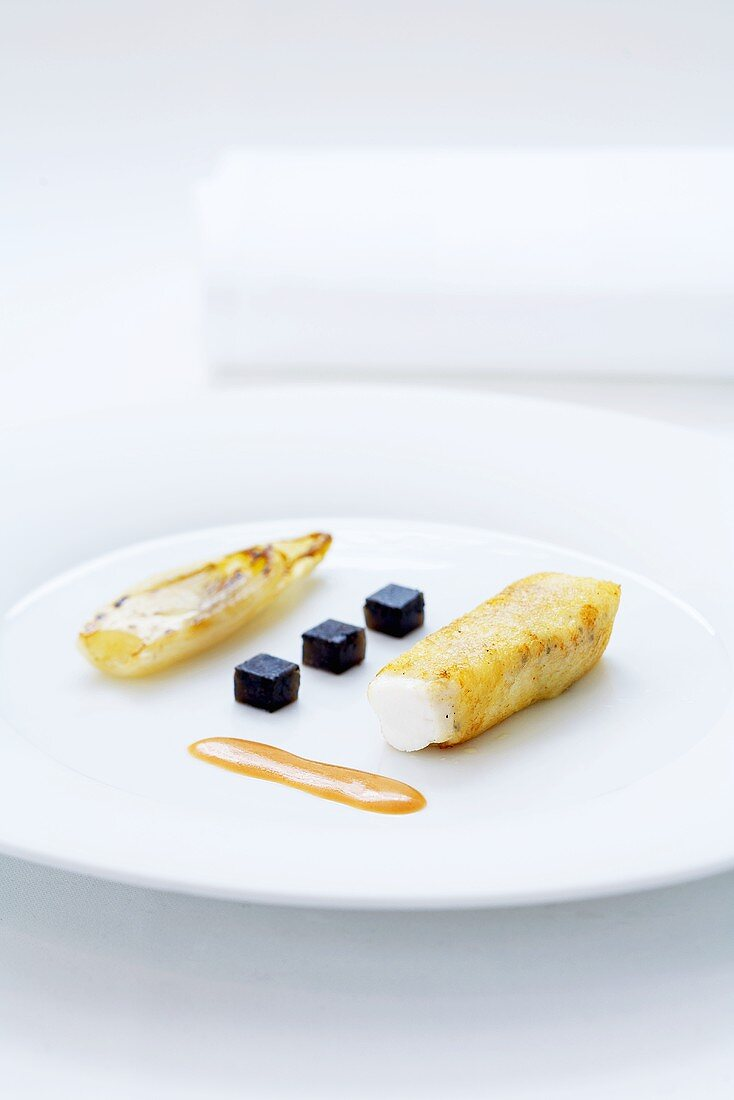 Turbot cannelloni with braised chicory and truffle jelly
