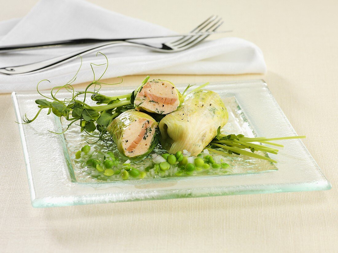 Lettuce leaf rolls filled with smoked salmon and a pea vinaigrette