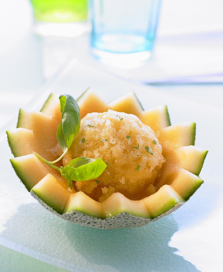 Melon sorbet with basil in a hollowed out melon