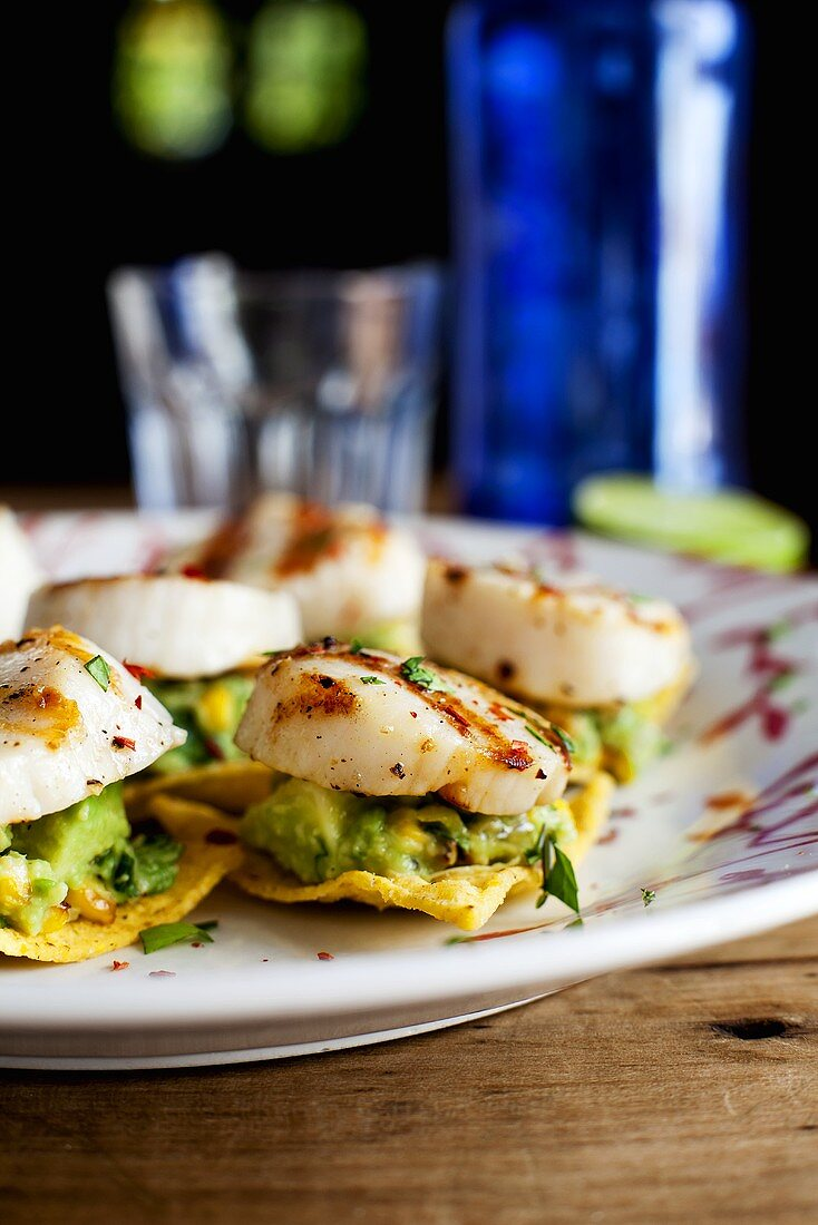 Grilled scallops with avocado-corn relish and nachos