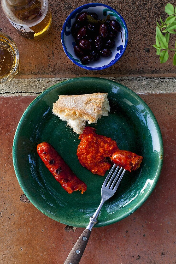Grilled pepper sausage with almond and pepper mayonnaise