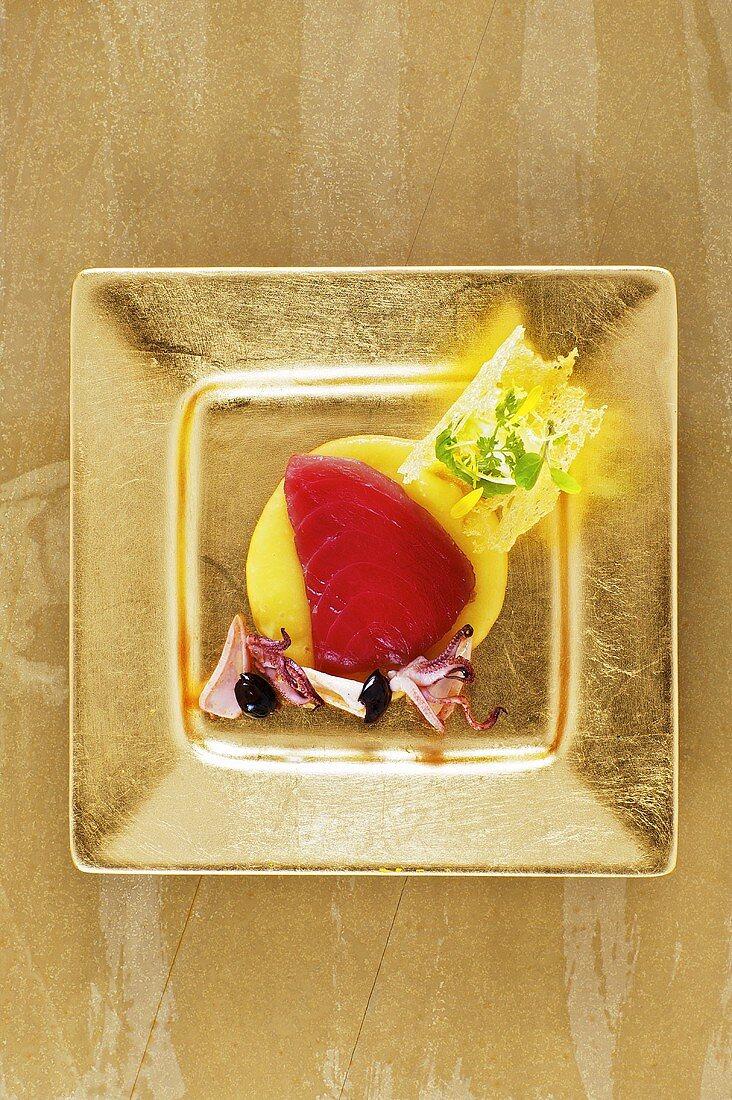 Marinated tuna with olive cream and squid