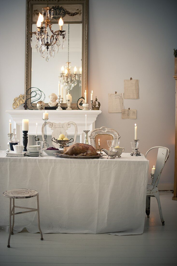 A festively laid Christmas table with roast goose