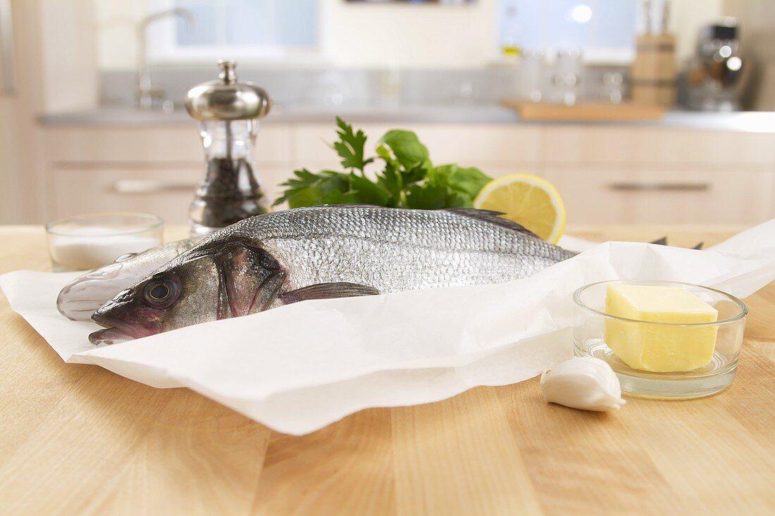 Sea bass, garlic, butter and herbs