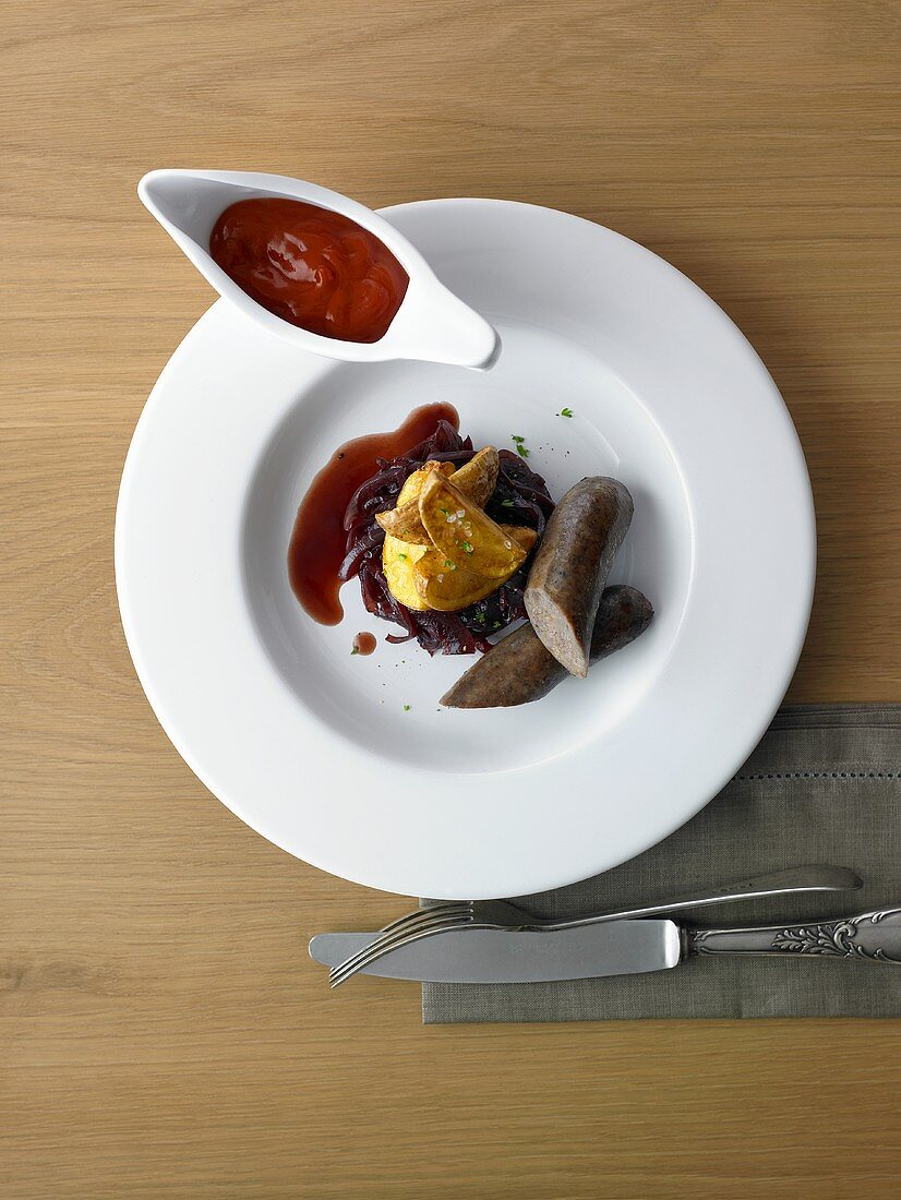 Flambeed buffalo sausage on onion confit with fried potatoes