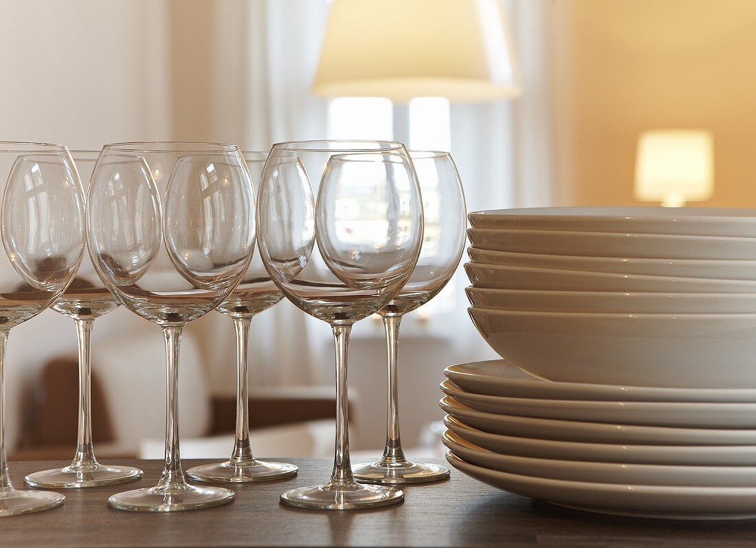 Wine glasses and a stack of plates