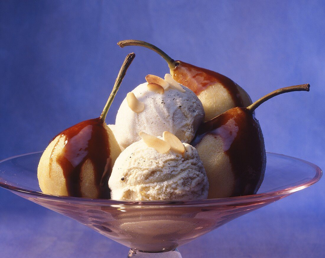 Poached pears with chocolate sauce and vanilla ice cream