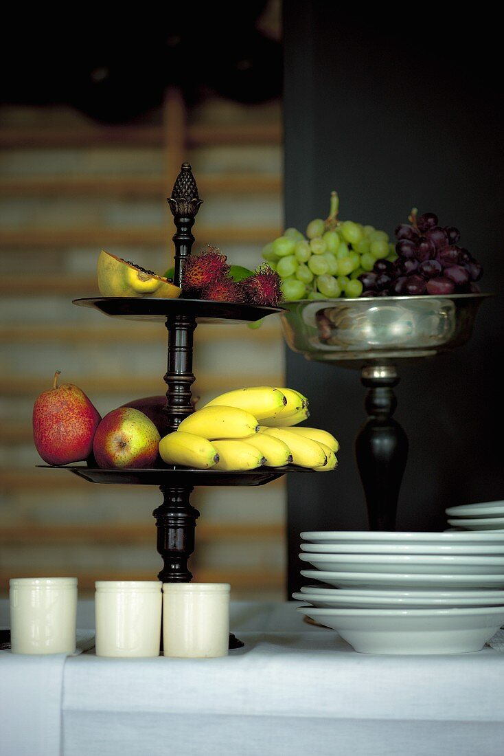 Fruit bowls and plates on a buffet table