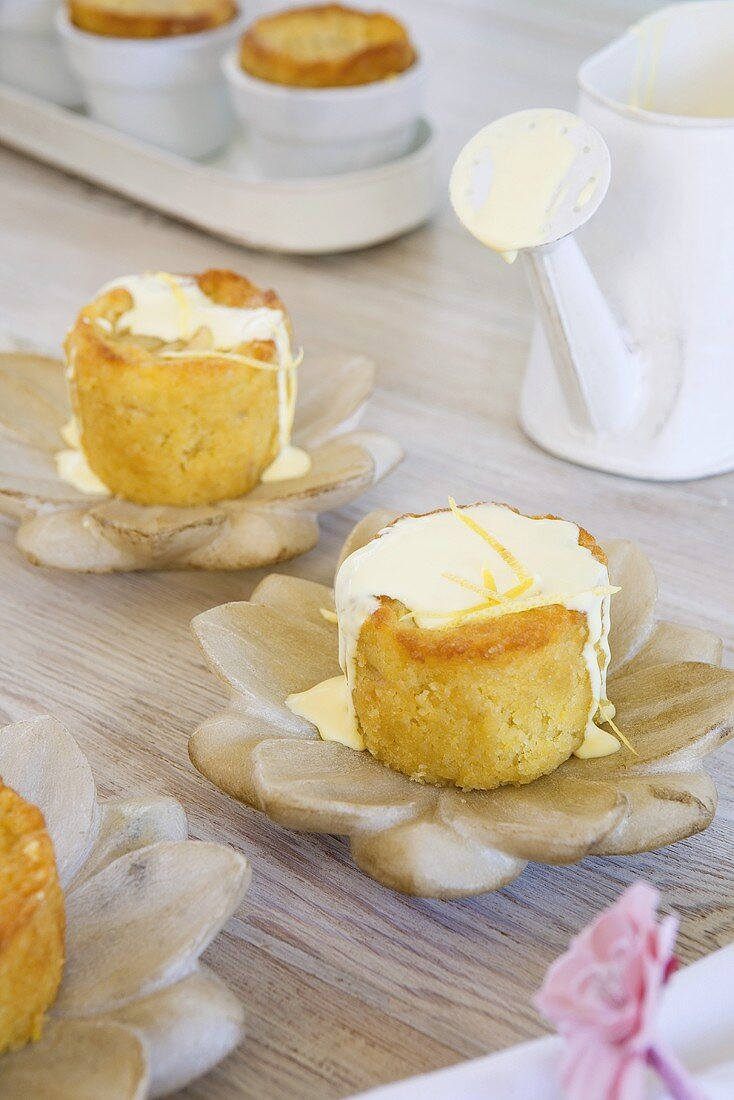 Baked pear and almond puddings with lemon cream