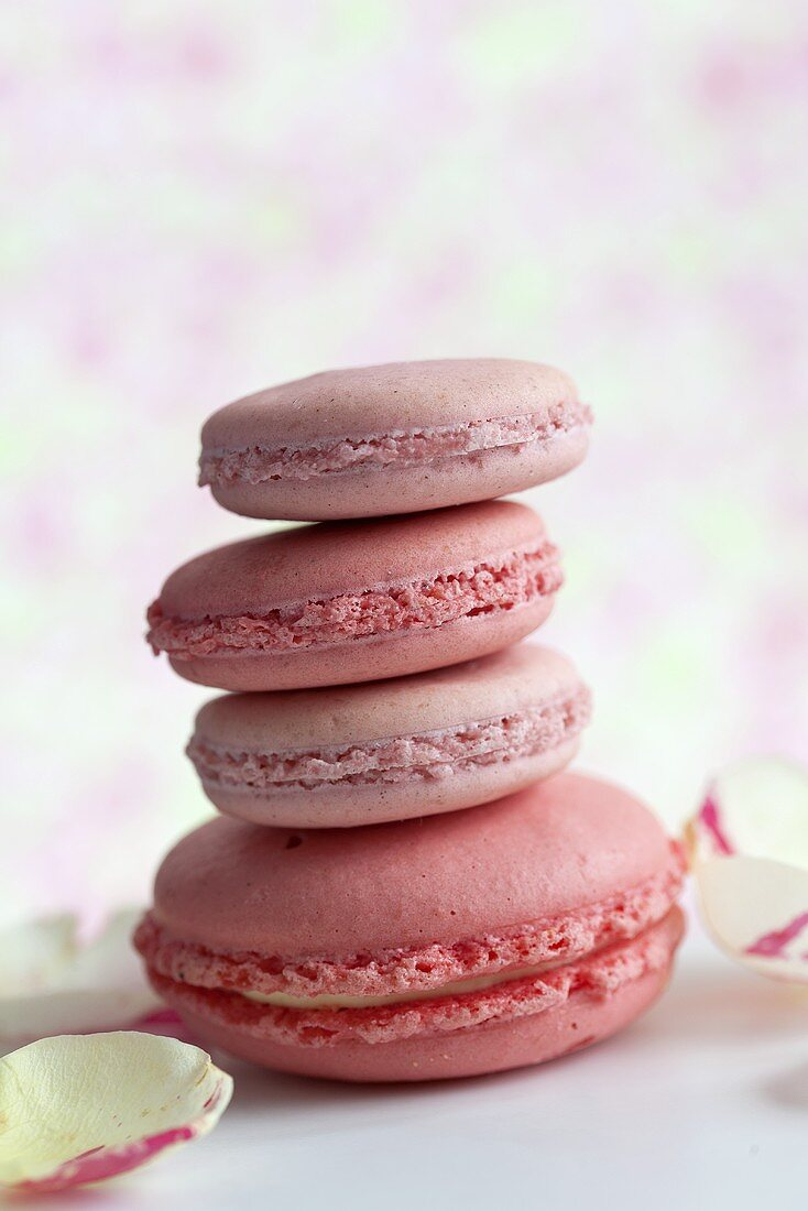 A stack of rose and strawberry flavoured macaroons