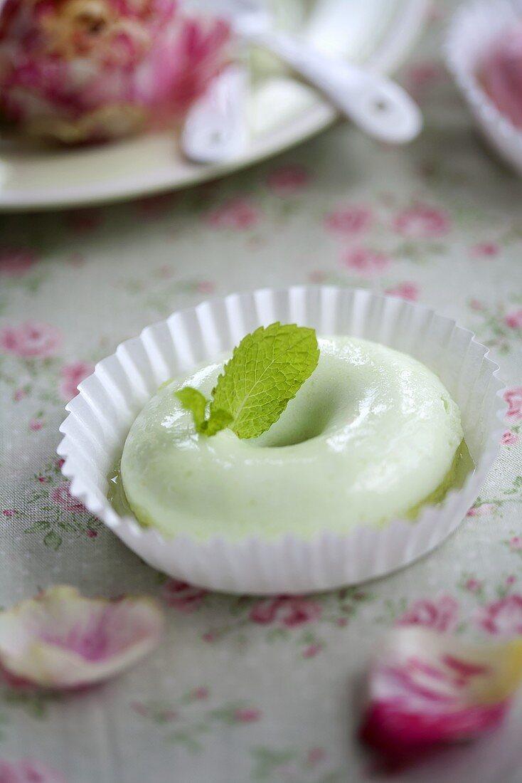A melon cream doughnut with a peppermint leaf